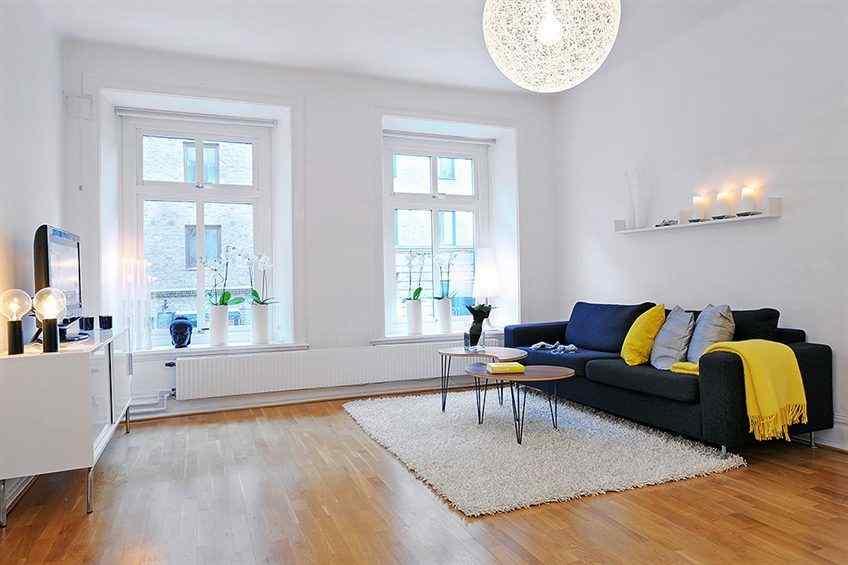 Departamento n rdico moderno en blanco con detalles en colores for Fotos decoracion apartamentos modernos