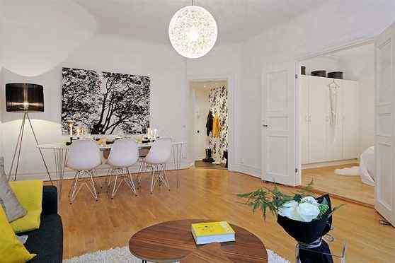 Departamento moderno en blanco con detalles en colores 4