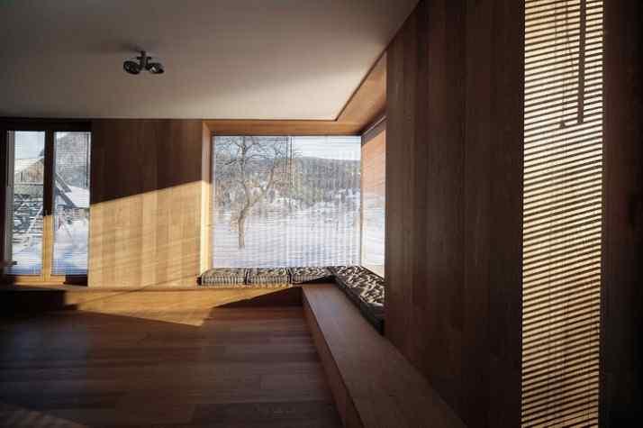 Diseño interior y exterior moderno contemporáneo en una cabaña alpina 7