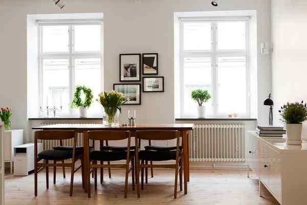 Puro blanco y mucha madera en la decoración de un departamento de 2 ambientes 4