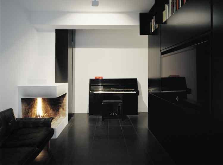 Decoración de interiores: Departamento pequeño minimalista en negro 1