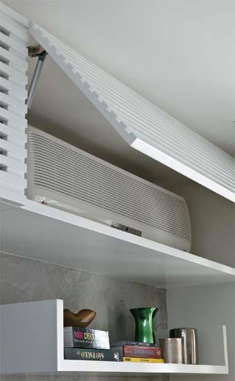 Diseño de interiores de departamentos modernos: mueble que esconde el aire acondicionado
