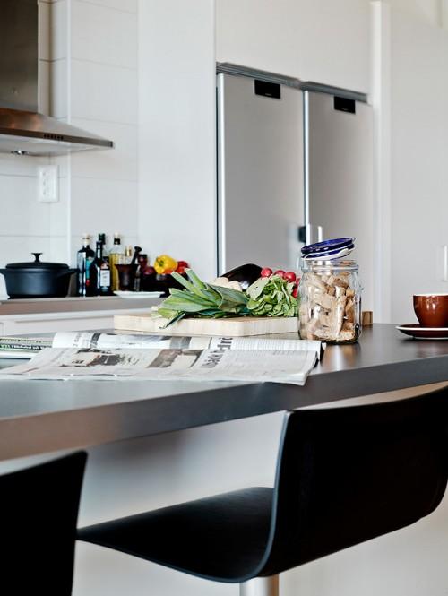 Barra de cocina en departamento estilo loft