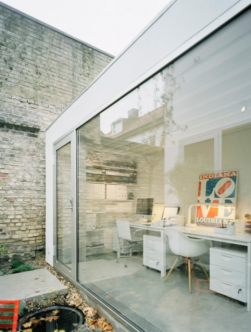 Home office en casa de estilo loft