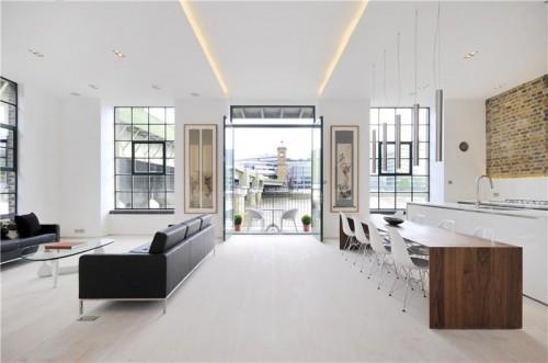 Departamento con diseño de interiores contemporáneo: living comedor