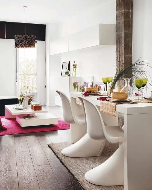 Comedor con sillas Panton en duplex estilo loft