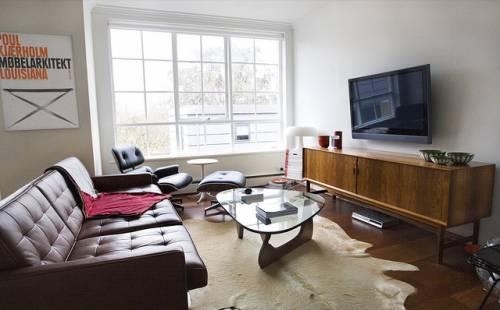 Departamento sencillo con muebles de diseño 1