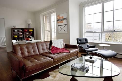 Departamento sencillo con muebles de diseño 6