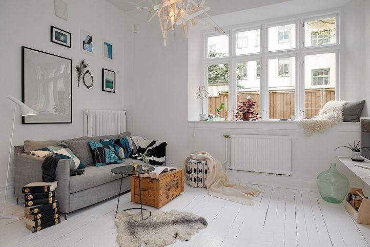 Living del monoambiente decorado en estilo nórdico con acentos contemporáneos