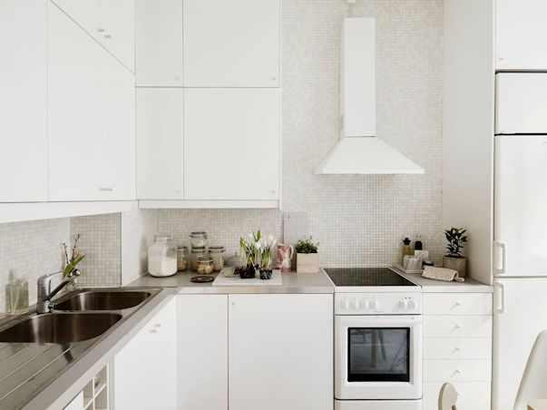 Interiores de un monoambiente nórdico con mucho estilo 8
