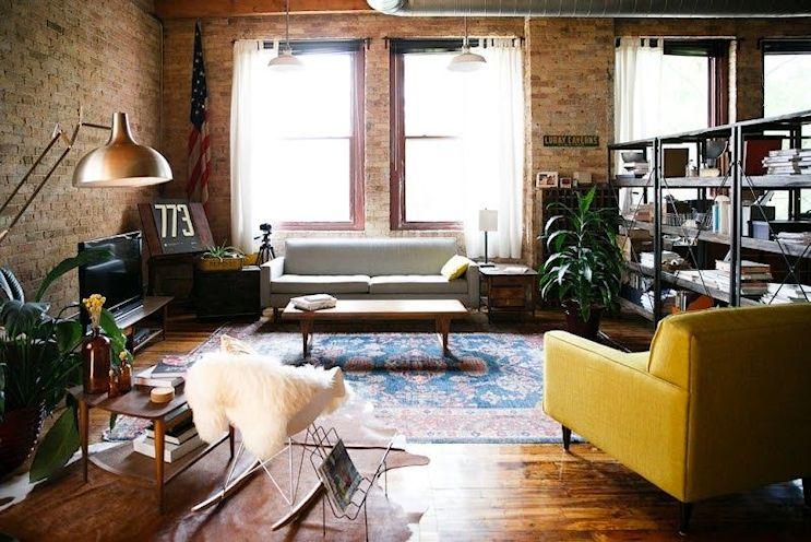 Loft de estilo industrial y vintage con ideas para dividir ambientes