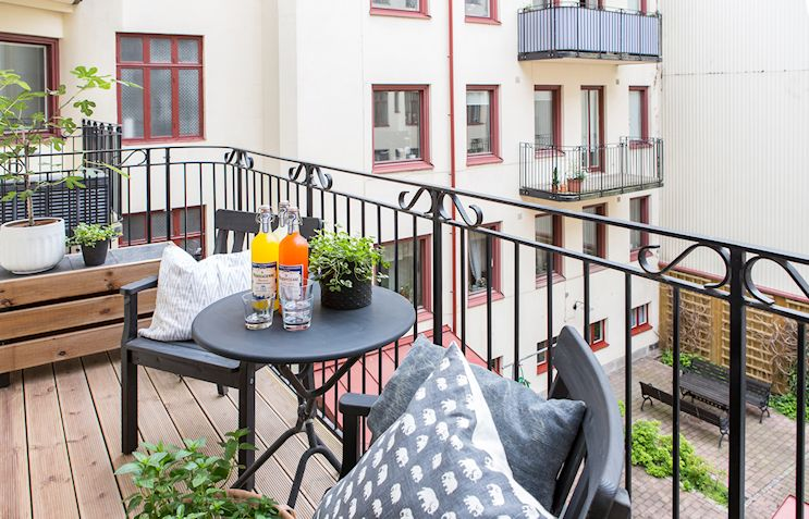 Interiores nórdicos en gris en un departamento de 2 ambientes 16