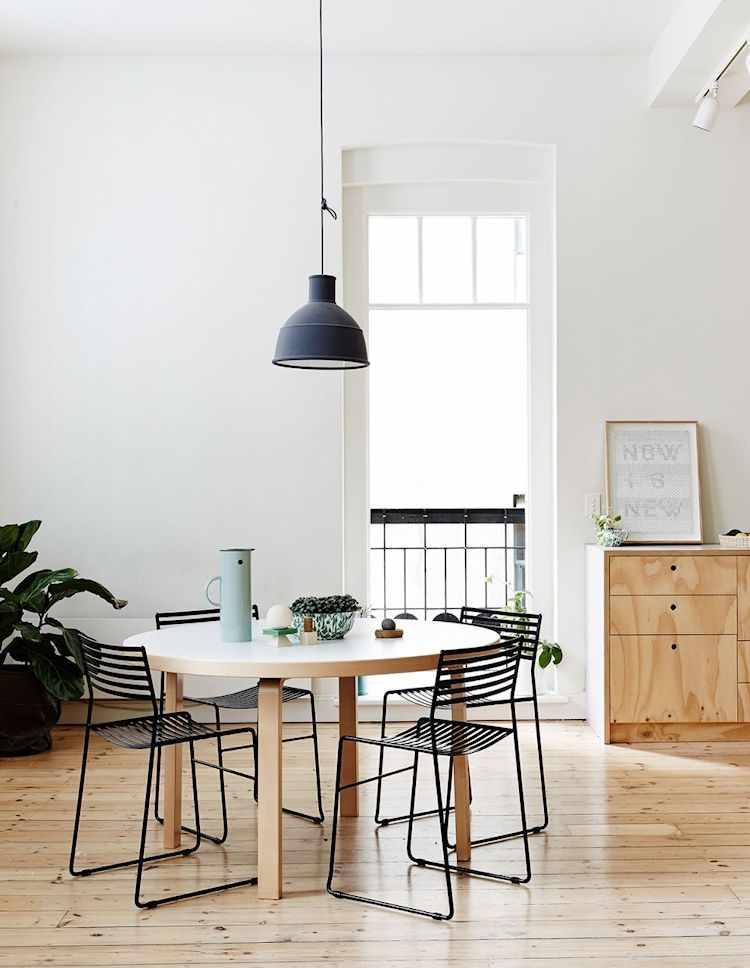 Comedor con mesa redonda para dar flexibilidad al espacio