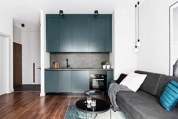 Departamento moderno de 2 ambientes con decoración sobria y masculina: cocina pequeña integrada al living