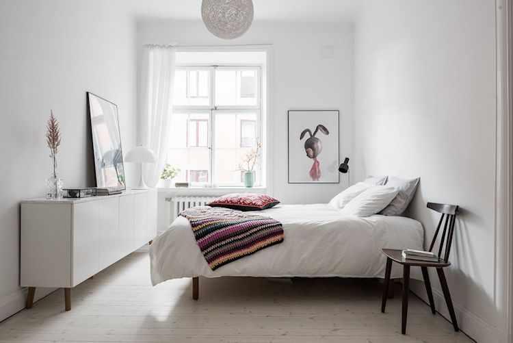Dormitorio con decoración nórdica y minimalista