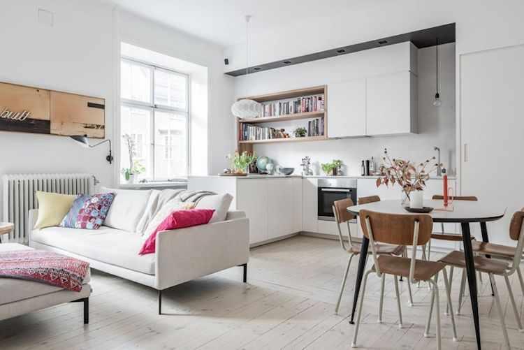 Ambiente principal de concepto abierto que integra el living, comedor y cocina