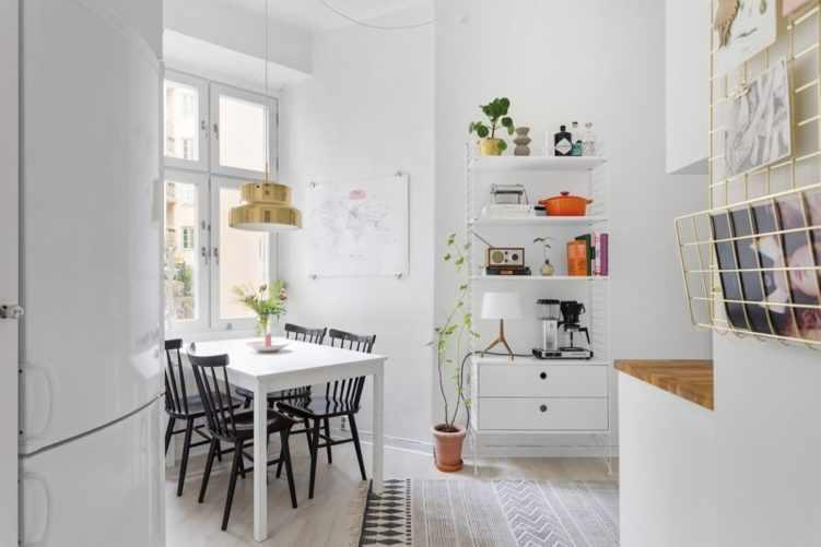 Deco nórdica en un monoambiente de 36 metros²: comedor integrado en la cocina 10