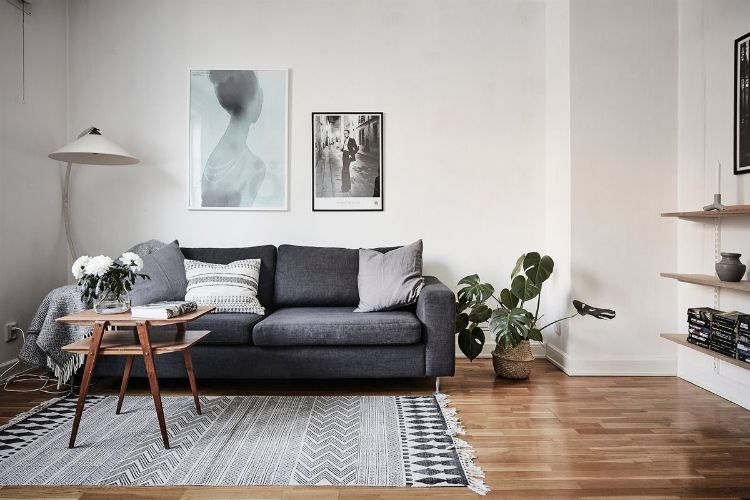 Area de estar / Living minimalista en el ambiente principal