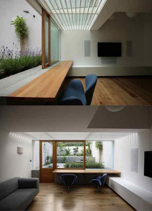 Anexo minimalista en casa de estilo victoriano